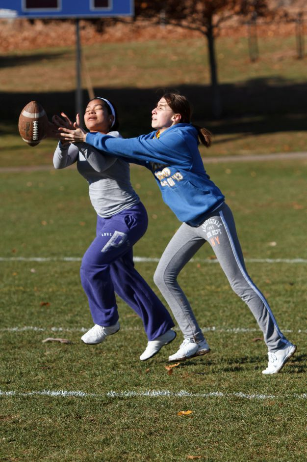 Bianca Ferguson 17 left and Eleana Farfan 17 try to catch a pass Saturday during Powder Puff practice at Wilcox Tech in Meriden Nov 15, 2014 | Justin Weekes / For the Record-Journal
