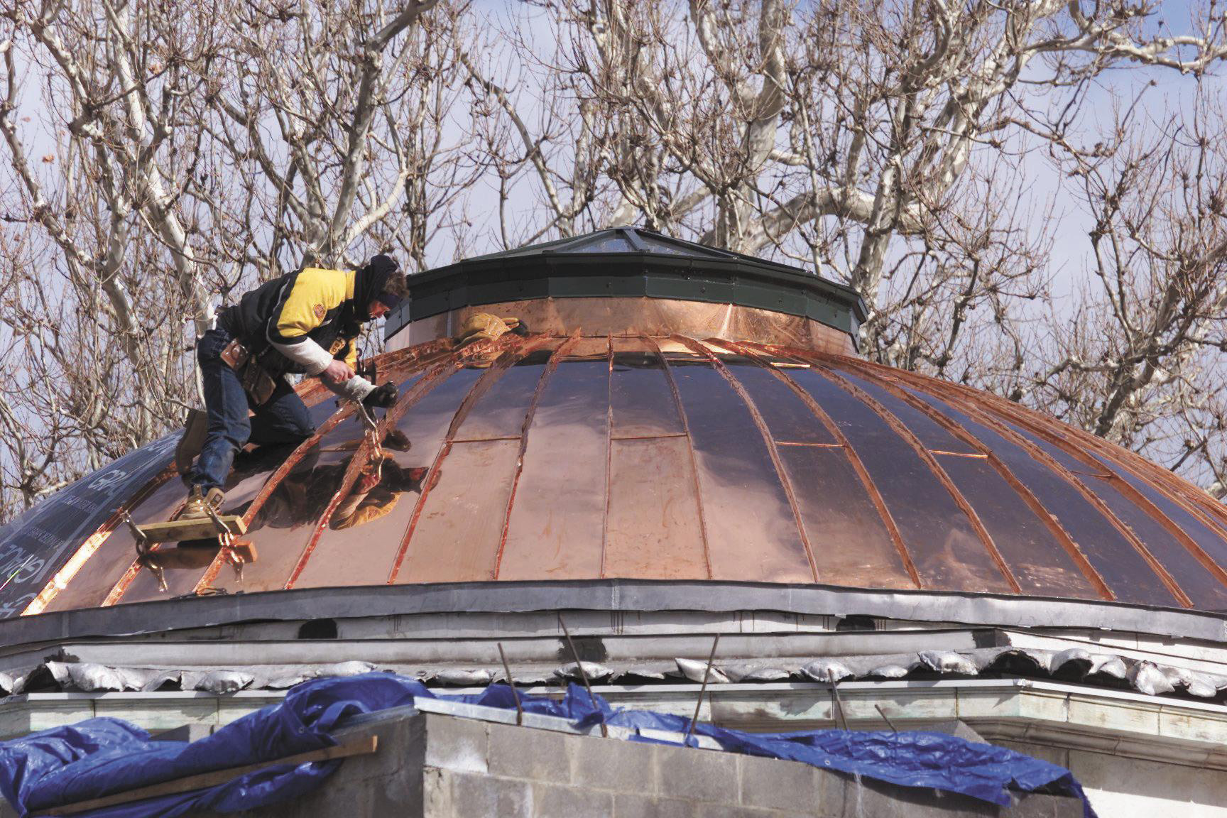Ken Palmer, of SRC Construction, Inc, of Meriden, installs a new copper roof to the Curtis Memorial Building in 2001 as part of the building's major renovations.| File photo, Record-Journal
