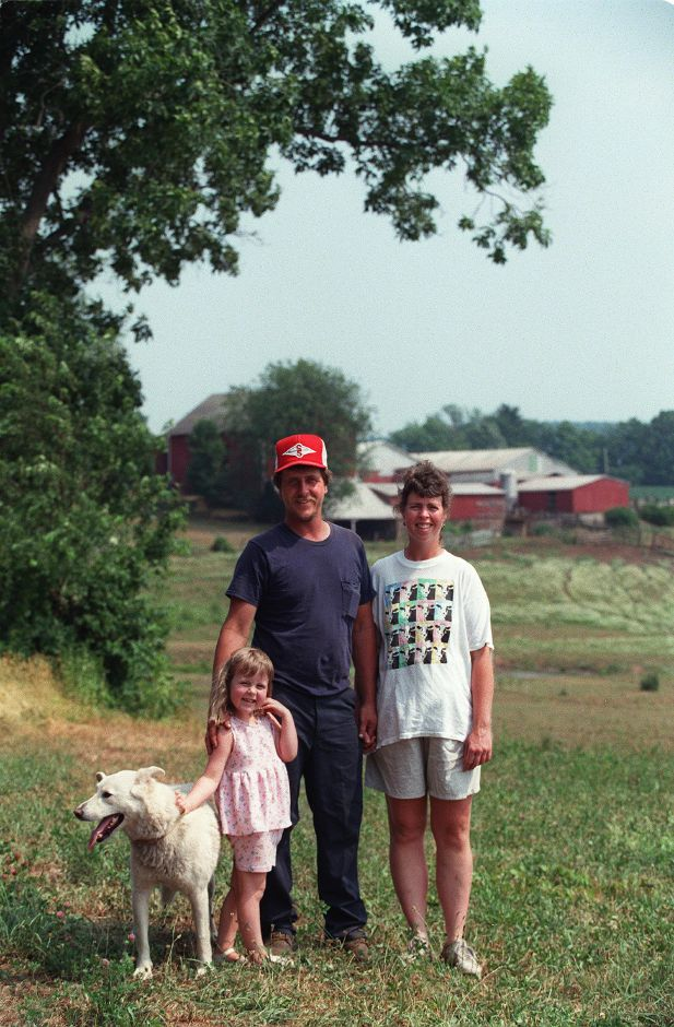 RJ file photo - The Footit Family at their farm off Northford Rd. : father David Footit, mother Kirsten Footit, 4-year old daughter Rachel Footit and their dog, Bubba. The farm which they have leased since 1996 was selected this year