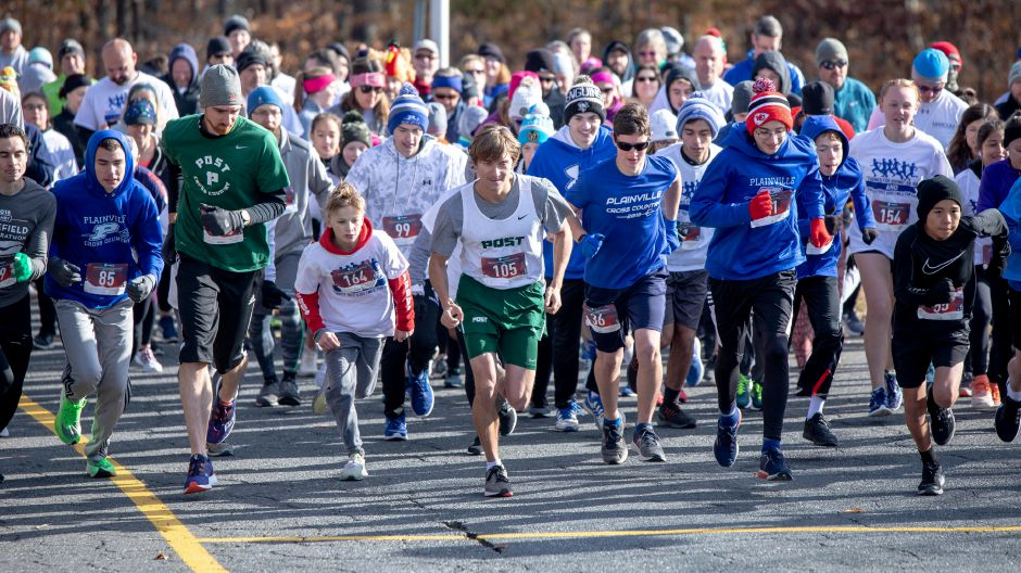 "Runners take off from the starting line in the ""Thanks for Giving"" race on Oct. 9, 2019. Looping around the Middle School of Plainville, the run raised around $7,000 — over half the money needed to fund the spring sports program at the school. 