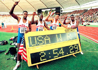 The U.S. 4x400 meter relay team, from left: Butch Reynolds, Andrew Valmon, Quincy Watts, and Michael Johnson celebrate the new world record set in Stuttgart, Germany on Aug. 22, 1993. (AP Photo/Thomas Kienzle)