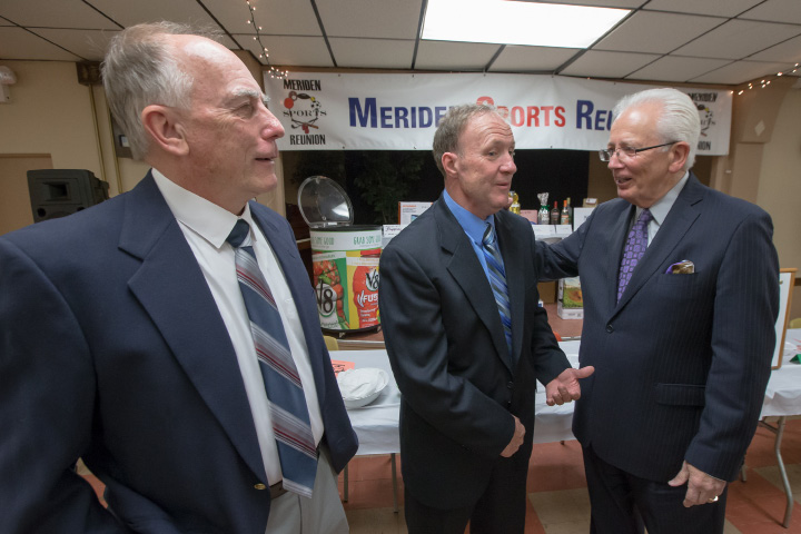 Meriden Sports Reunion emcee Al Terzi, right, visits with 2016 Meriden Sportsmen of Distinction Les Zimmerman, left, and Bob Hettrick Jr. at last year