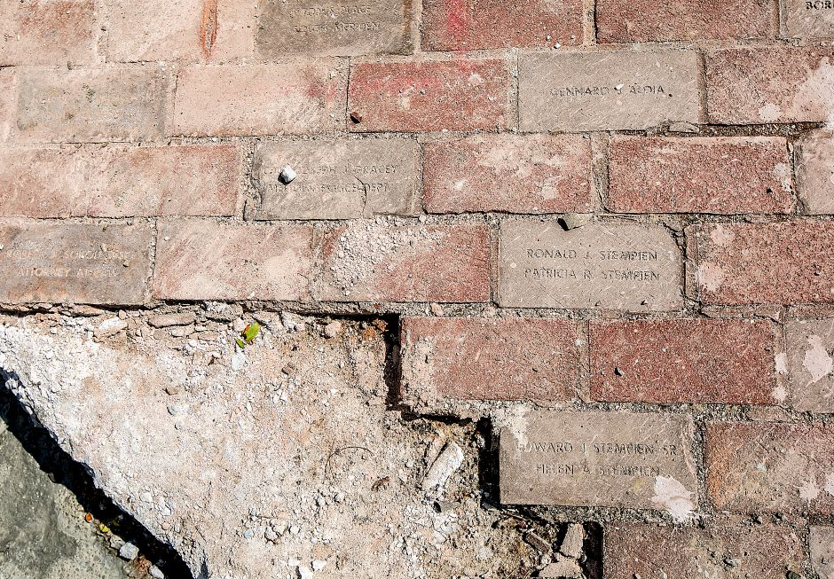 Personalized bricks along West Main Street in downtown Meriden, Friday, July 27, 2018. The personalized bricks lining sidewalks on West Main, Grove, Butler and other side streets are being torn up to make way for new sidewalks. The city has asked the contractor Colassale Construction to pledge a good faith effort to salvage them, which it has for the most part. Dave Zajac, Record-Journal