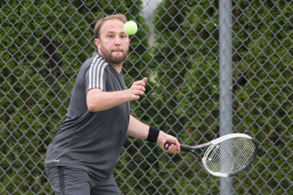 Phil Titolo, of West Hartford, plays a forehand volley in a mixed doubles match during the Wayton Open at Southington High School last summer. | Justin Weekes / For the Record-Journal