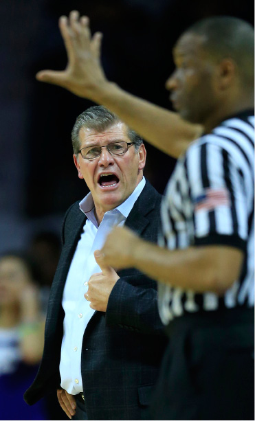 Connecticut head coach Geno Auriemma questions a call during the first half of an NCAA college basketball game against Kansas State in Manhattan, Kan., Sunday, Dec. 11, 2016. (AP Photo/Orlin Wagner)