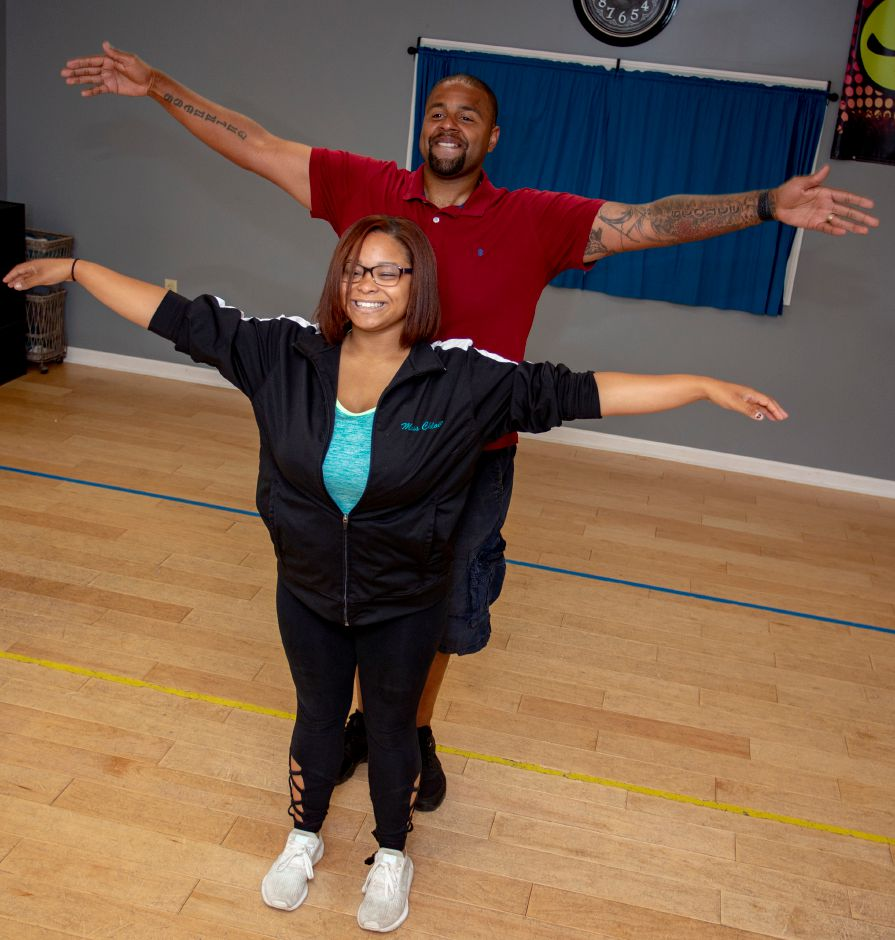 "Chloie McMahon, Higher Movement dancing instructor, and Meriden police officer Joseph Stoute practice their routine for ""Dancing with the Stars of Meriden,"" which raises money for Seniors Have Dreams Too, an organization that grants wishes to senior citizens."