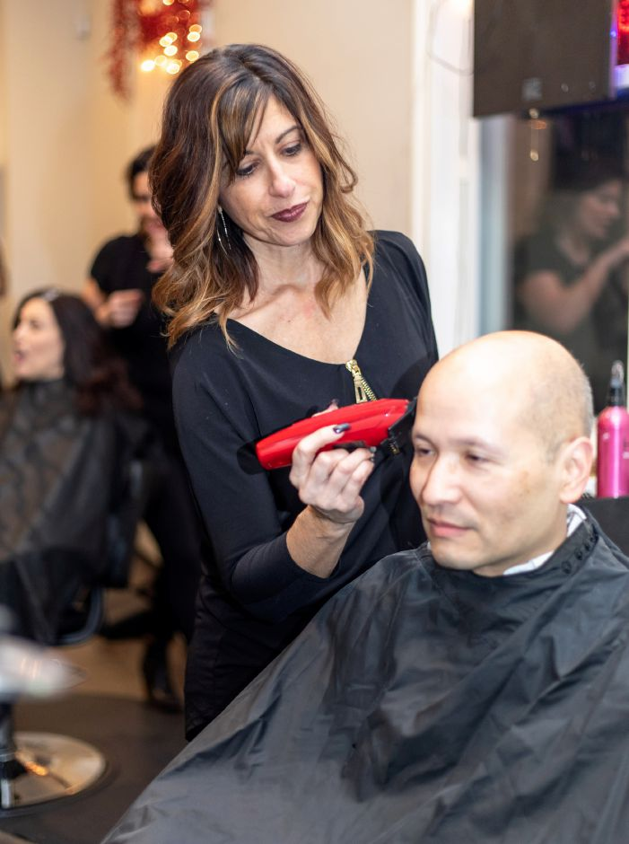 Donna Theriault touches up David Velasco