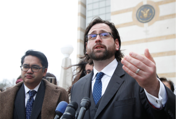 Justin Cox of the National Immigration Law Center, representing all the plaintiffs, right, accompanied by Omar Jadwat of the ACLU, speaks to reporters outside the court in Greenbelt, Md., Wednesday, March 15, 2017. A federal judge in Maryland says he will issue a ruling in a lawsuit challenging President Donald Trump