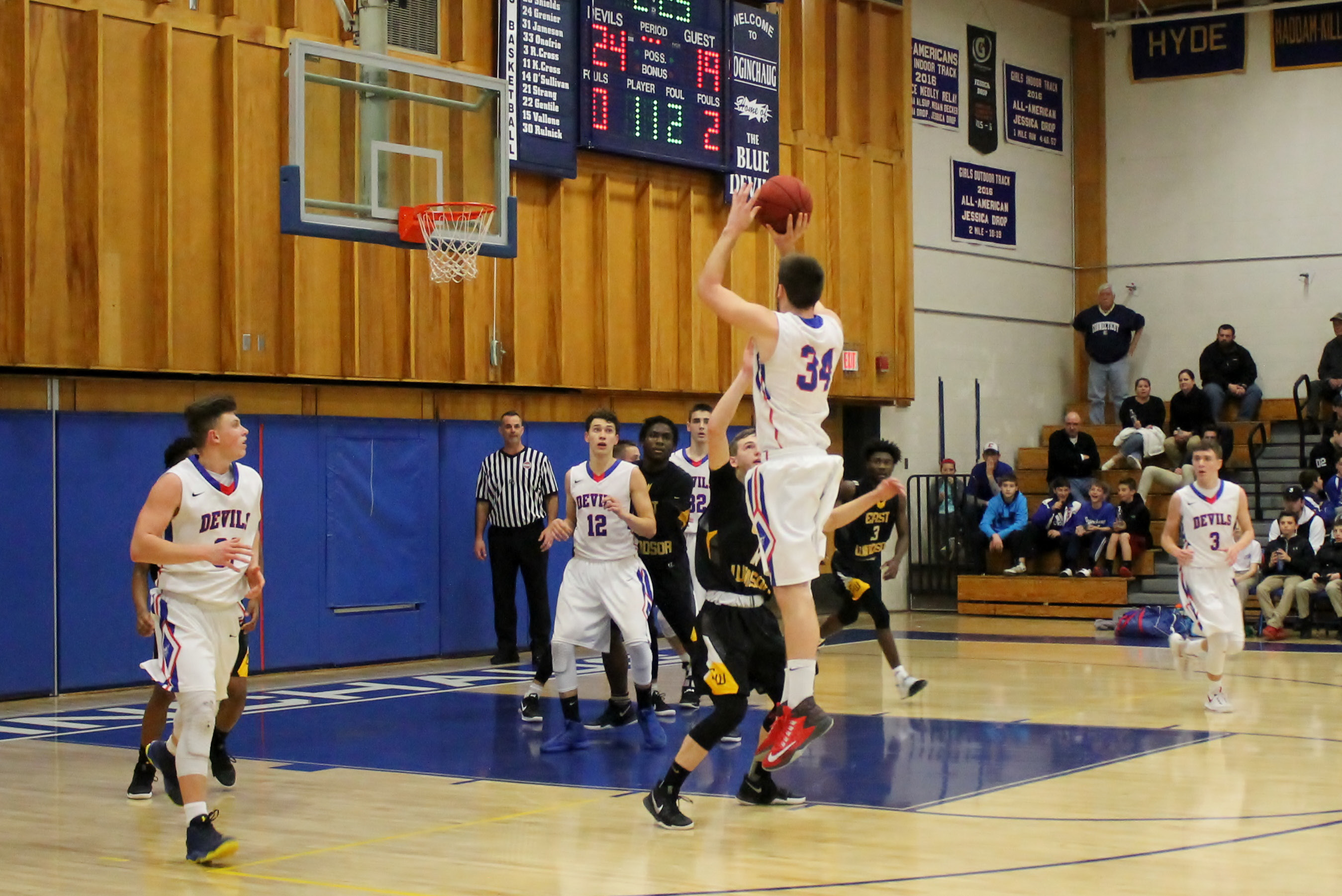 Elevating for a jump shot, Coginchaug boys basketball player Jack Murphy tries to extend the lead for the Blue Devils against East Windsor on March 7. The game went to double overtime before Coginchaug won, 50-46.| Mark Dionne, Town Times