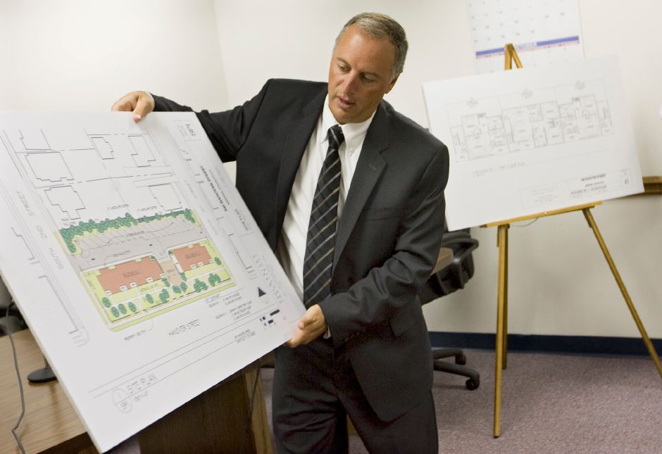 FILE PHOTO: Robert Cappelletti, executive director of the Meriden Housing Authority shows an overview of proposed Veteran