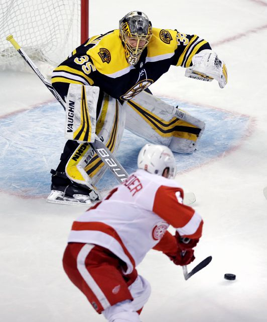 Boston Bruins goaltender Anton Khudobin (35) tracks the puck as Detroit Red Wings left wing Justin Abdelkader skates past during the first period of an NHL hockey game in Boston, Tuesday, March 6, 2018. (AP Photo/Charles Krupa)