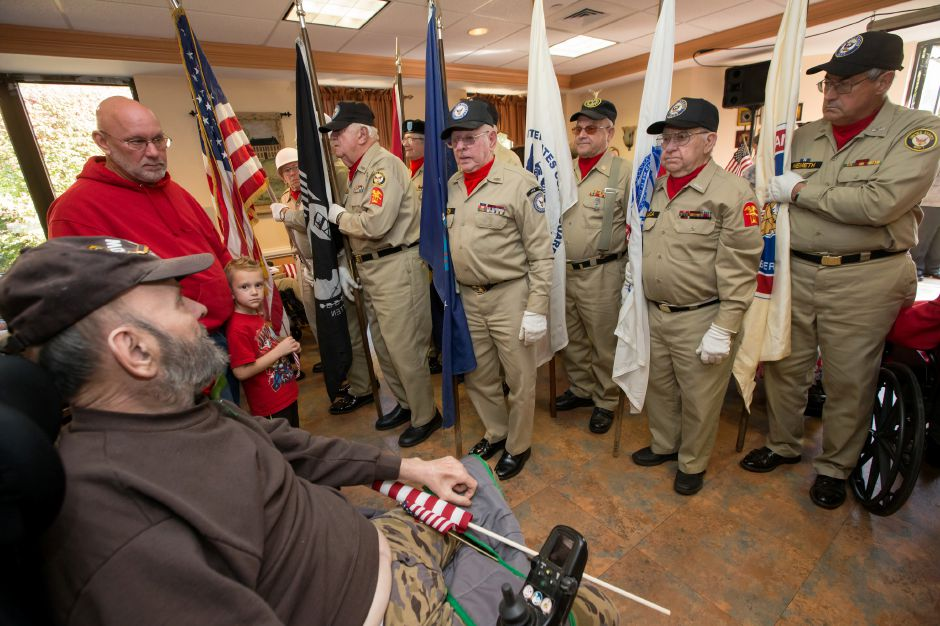 Airforce veteran Albert Cambo directs his attention to the flag during the National Anthem Friday during a Quilts of Valor ceremony at The Summit at Plantsville in Plantsville October 27, 2017 | Justin Weekes / For the Record-Journal