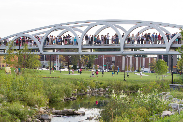 Pedestrians cross the Silver City Bridge after the grand opening of the Meriden Green in downtown Meriden Friday Sep. 9, 2016 | Justin Weekes / For the Record-Journal