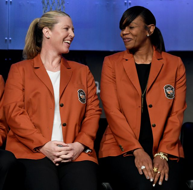 Basketball Hall of Fame inductees Katie Smith left, and Tina Thompson, smile as they sit together during a news conference at the Naismith Memorial Basketball Hall of Fame, Thursday, Sept. 6, 2018, in Springfield, Mass. (AP Photo/Jessica Hill)