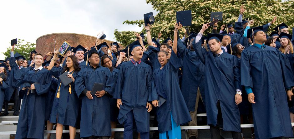Members of the class of 2015 celebrate at conclusion of graduation ceremonies at Platt High School in Meriden, Friday, June 19, 2015. | Dave Zajac / Record-Journal
