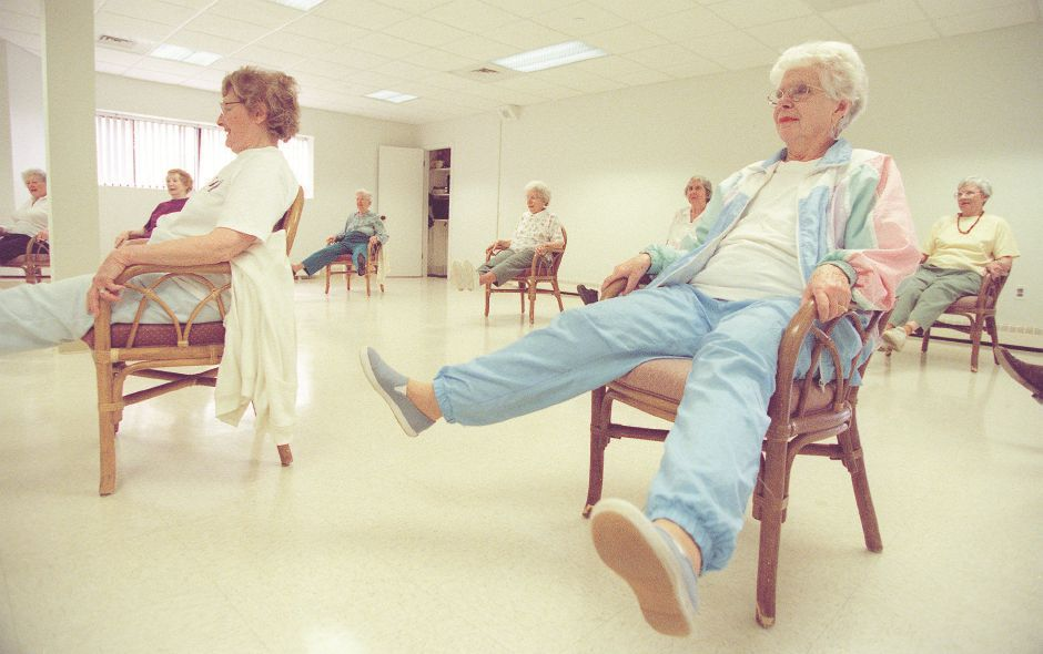 RJ file photo - Debbie Milton, right, waves her legs around during low impact aerobics class at Ashlar Village in Wallingford, May 1998.
