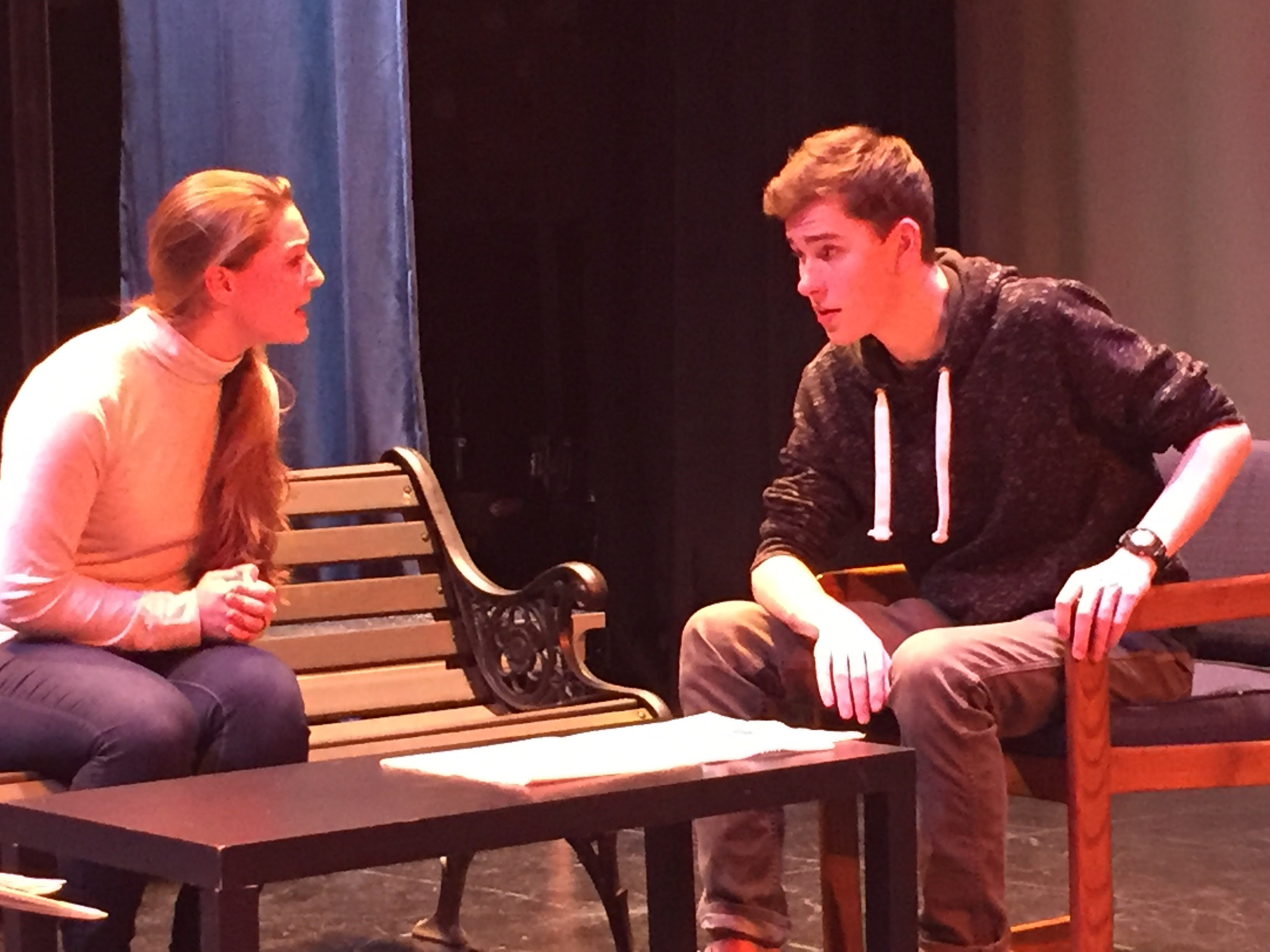 "Plainville High School students Kloe Hidri and Jackson Anderson act out a scene from their upcoming performance of ""All My Sons."" 
