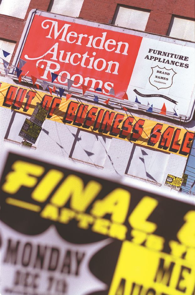 RJ file photo - Banners were everwhere during the final days of the going-out-of-business sale at Meriden Auction Rooms, Dec. 1998.