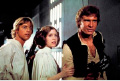 "This photo provided by Twentieth Century Fox Home Entertainment shows, Mark Hamill, from left, as Luke Skywalker, Carrie Fisher as Princess Leia Organa, and Harrison Ford as Hans Solo in the original 1977 ""Star Wars: Episode IV - A New Hope"" film, included in the new Blu-ray release of  ""Star Wars: The Complete Saga"" out on Oct. 13, 2015. The new film, ""Star Wars: The Force Awakens,"" opens in U.S. theaters on Dec. 18, 2015. (Twentieth Century Fox Home Entertainment via AP)"
