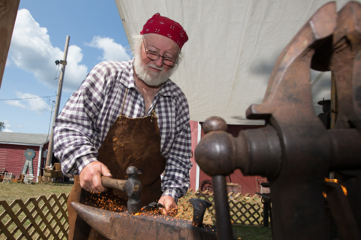 Al Kostuk of Pisgah Mountain Primitives hammers a piece of steel in a Black Smith demonstration Sunday during the 75th Annual North Haven Fair in North Haven September 10, 2017 | Justin Weekes / For the Record-Journal