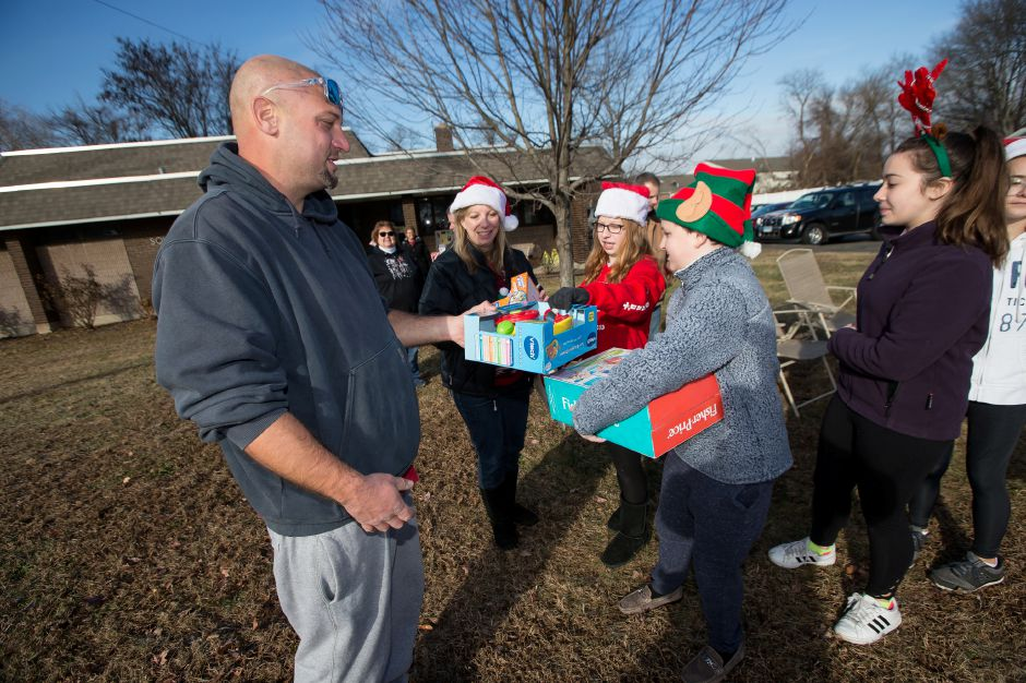 Glenn Parciak of Southington drops off toys Sunday during the 5th Annual Valerie