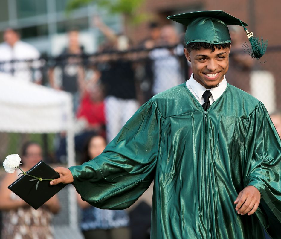 Graduate Santos Chappell is all smiles after receiving his diploma during graduation ceremonies at Maloney High School in Meriden, Tuesday, June 13, 2017. | Dave Zajac, Record-Journal