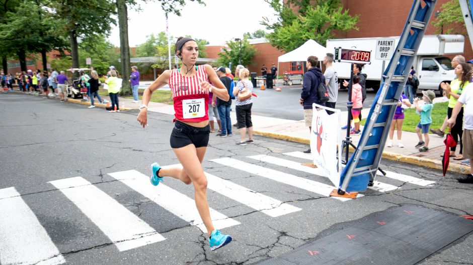 Kathleen Kalbian crosses the finish line of the Chip's Family Restaurant 5k Road Race. The Petit Family Foundation holds the race every year to raise money for the foundation
