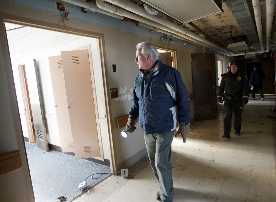 Thomas Kilroy, chief housing inspector, walks a hallway on the seventh floor while touring the former Meriden-Wallingford hospital on Cook Ave. in Meriden, Thursday, January 9, 2014. | Dave Zajac / Record-Journal