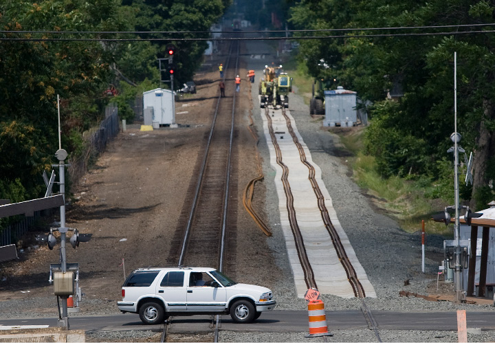 A view looking north from the new Wallingford train station shows an SUV crossing tracks on Parker Street as construction of the Hartford Line continues in Wallingford, Wednesday, July 6, 2016.  | Dave Zajac, Record-Journal