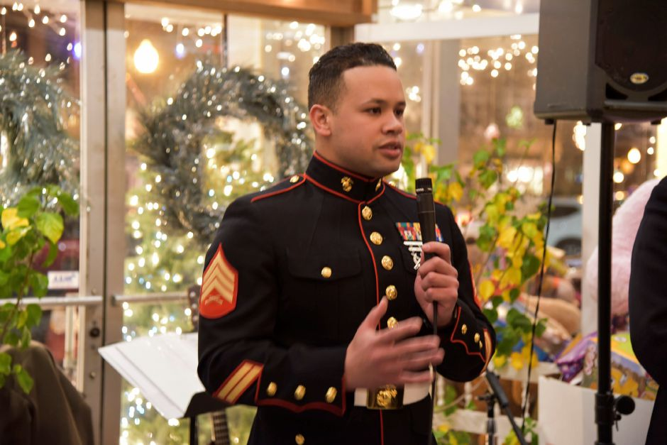 Sargent Luis Colomba of the New Haven Marine Corps. speaks to the crowd gathered for the 27th annual Toys for Tots fundraiser at their 27th annual event at Gaetno
