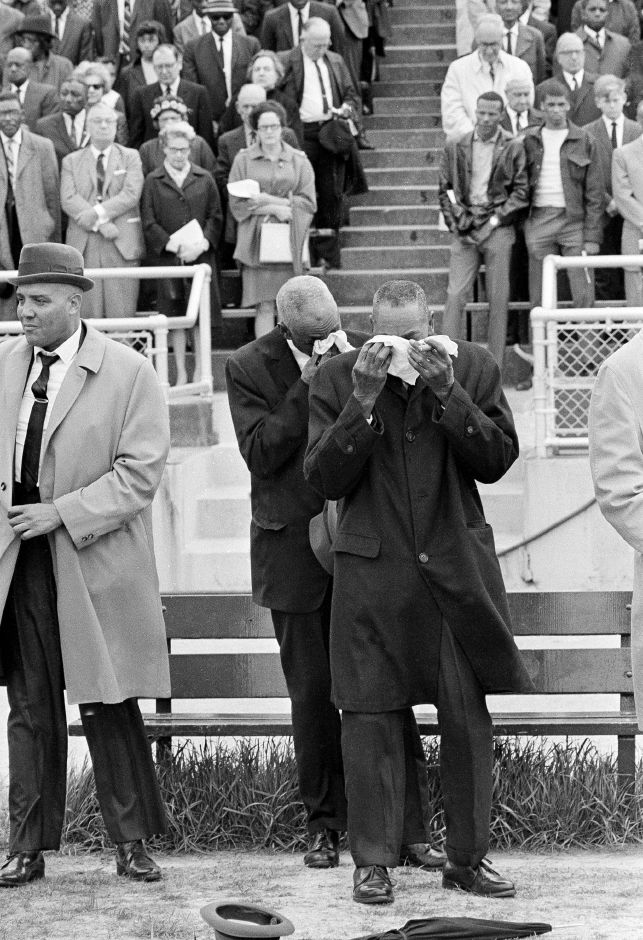 "Two elderly men weep openly during the playing of the National Anthem at a memorial service at Crump Stadium in Memphis, Tenn., April 7, 1968, in honor of Dr. Martin Luther King, Jr., who was assassinated in Memphis last Thursday. Walter Bradin, 66, right, of Memphis, said ""I love him (King), I love that song."" (AP Photo)"