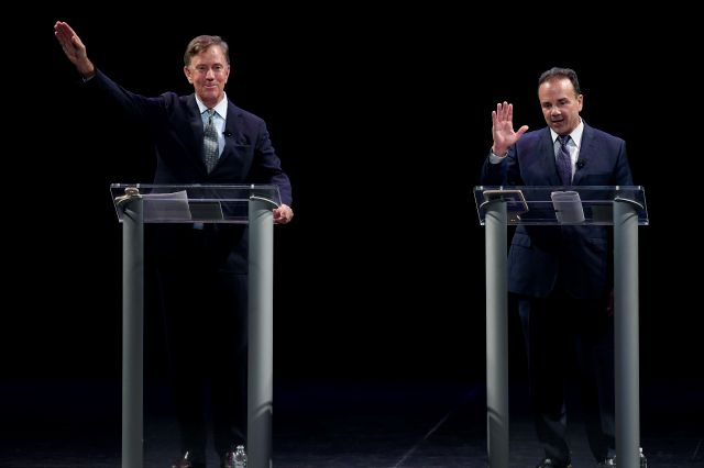 FILE - In this Thursday, July 12, 2018, file photo, Democratic gubernatorial candidates Ned Lamont, left, and Bridgeport Mayor Joe Ganim wave at the end of debate in New Haven, Conn. Lamont is the party