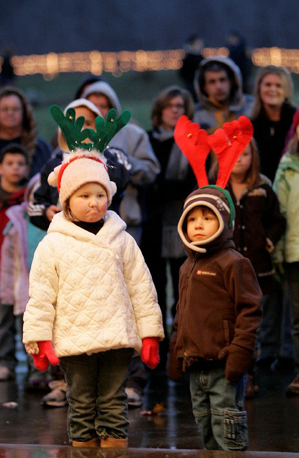 Record Journal Photo/ Johnathon Heninger 12.09.08 - Luke Carabetta, 2, left, with cousin, Ellie Galasso, 3, watch middle schoolers play instruments and sing Christmas Carols at Christmas in the Park in Meriden