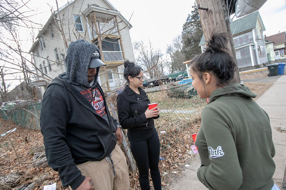 Left to right, Trevor Hicks Jr., Yaricely Zenquis, and Brianna Torres, all of Meriden, reflect at a memorial for their friend Aaron Joseph Ormsby, 21, on Foster Street in Meriden, Fri., Jan. 18, 2019. Ormsby was shot and killed in back of a residence at 130 Foster St. Thursday night. Dave Zajac, Record-Journal