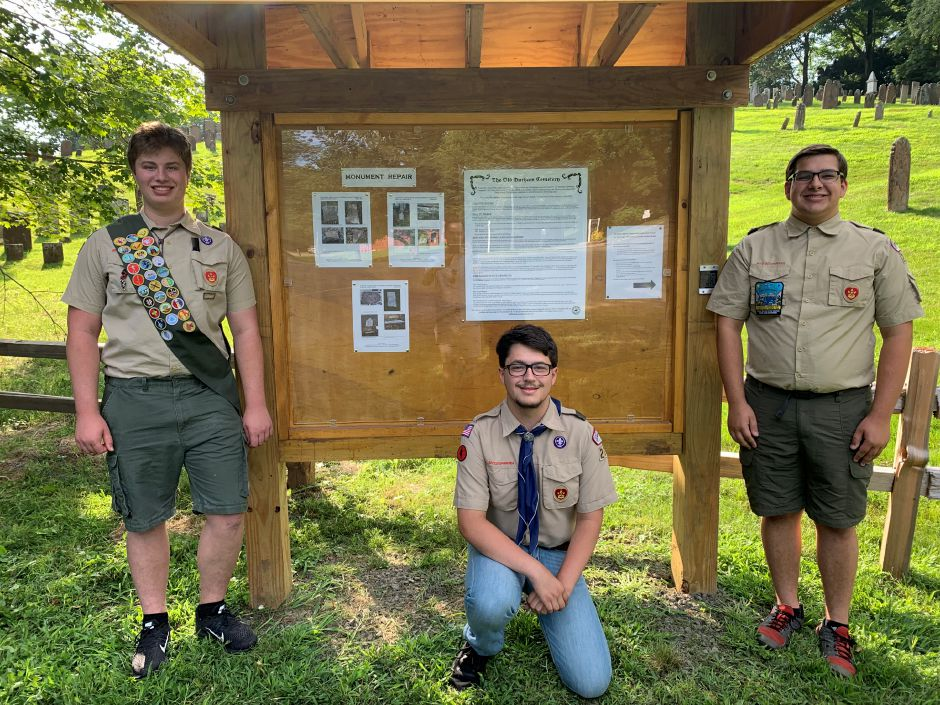 Andrew Bengston, Wyatt Pedersen and Duncan Bates pose next to their projects at Durham Cemetery.  Photos by Everett Bishop, Town Times.