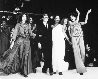 At the end of his Spring-Summer Ready-to-Wear collection, Yves Saint Laurent walks with his models along the catwalk, in Paris, France, Oct. 21, 1981. (AP Photo)