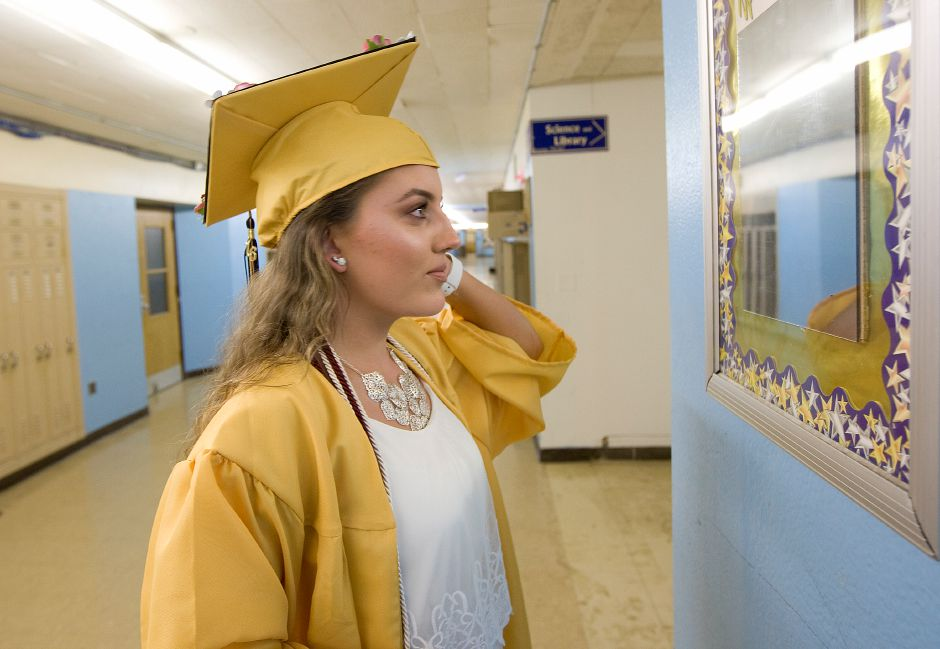 Natalia Giacco, 17, stops at a hallway mirror before the start of graduation ceremonies at Platt High School, Thursday, June 9, 2016. | Dave Zajac, Record-Journal