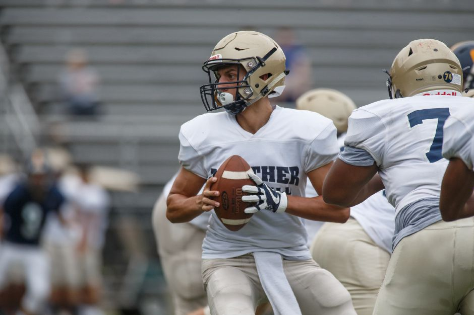 Platt quarterback Lorenzo Sanson drops back to pass during Friday's scrimmage with Simsbury at Falcon Field. | Justin Weekes / Special to the Record-Journal