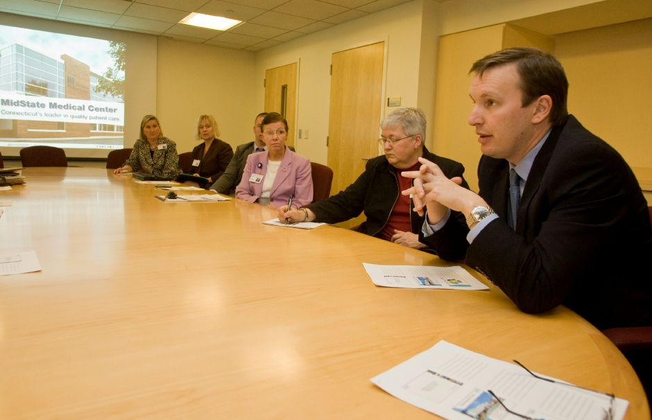 Rep. Chris Murphy, right, talks with information specialists and other staff at MidState Medical Center in Meriden, Jan. 23, 2009. Murphy was in town to discuss some of the possible changes in healthcare law and it
