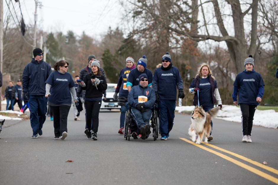 Scott DeFilio is pushed by friends Sunday during the Kiwanis Turkey Trot at Stevens School in Wallingford. Justin Weekes, special to the Record-Journal