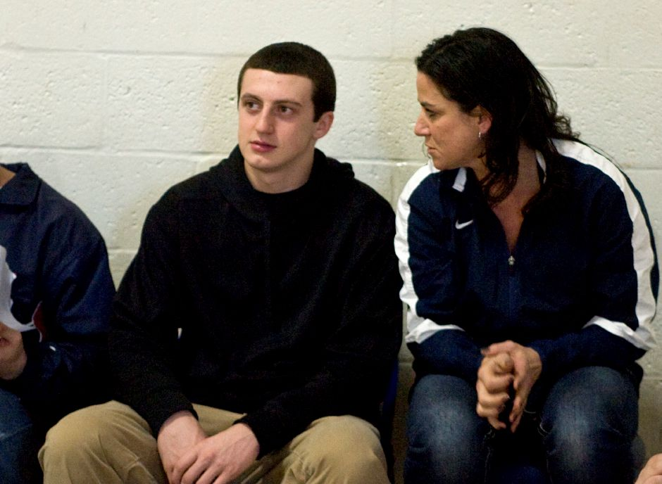 Lyman Hall senior and basketball player Kyle Upton (left) chats with trainer Janine Kozik in between the double header games against Sheehan at Lyman Hall High School in Wallingford. Kozik was on hand last Friday when Upton fell and fractured his skull. Upton was not playing in this evening