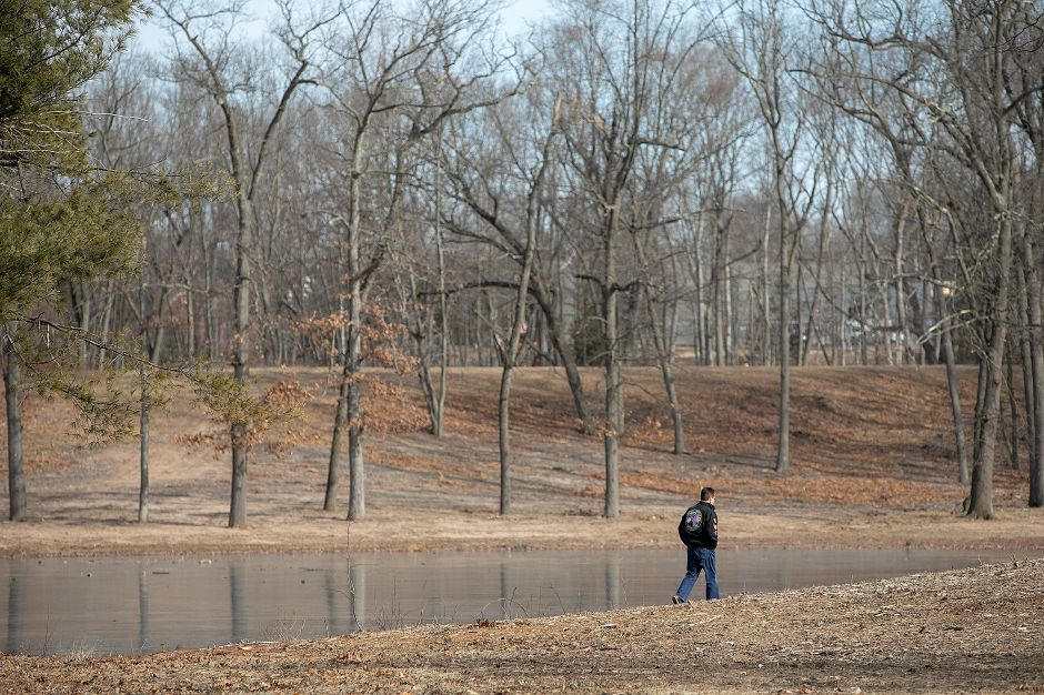 Dennis Taricani, of Berlin, walks along the pond at Wharton Brook State Park in Wallingford, Tues., Jan. 15, 2019. The park has reopened after a microburst in May of 2018 shut it down. Dave Zajac, Record-Journal