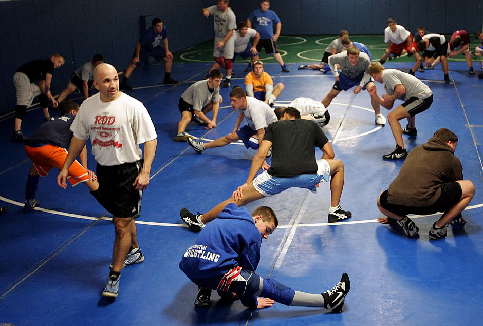 Southington wrestling team stretch out in their new facility at the high school December 15, 2008. At bottom center is freshman Pat Hamel, 14, who wrestles in the 112 weight class. At left is coach Zaccanino . (dave zajac photo)