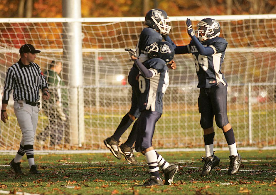 Meriden Raider Jon (cq) Foster leaps into the arms of teammate Kendall Thomas and Joey Felton after scoring a touchdown in the second half against the Waterbury Knights during a Junior Midget Division game at Falcon Field in Meriden November 2, 2008. Meriden beat Waterbury 35-6 . (dave zajac photo)