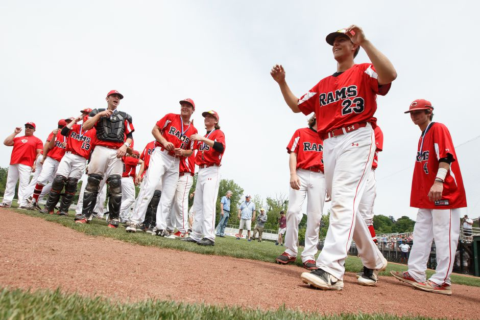 Cheshire senior Ben Shadeck walks up to receive his medal Saturday after the CIAC Class LL baseball final at Palmer Field in Middletown. The Cheshire Rams defeated Ridgefield 1-0. | Justin Weekes / Special to the Record-Journal