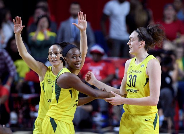 FILE - In this Wednesday, Sept. 12, 2018, file photo, from left, Seattle Storm