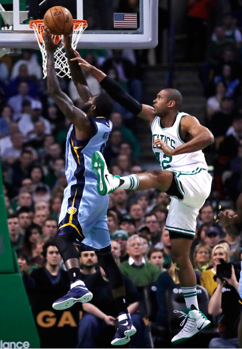 Memphis Grizzlies forward JaMychal Green, left, and Boston Celtics center Al Horford, right, reach for a rebound during the first quarter of an NBA basketball game in Boston, Tuesday, Dec. 27, 2016. (AP Photo/Charles Krupa)