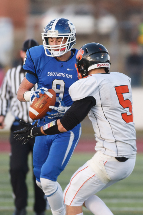 Southington's Alex Jamele intercepts a pass intended for Ridgefield's Andrew Chuma, turning it into a touchdown. | Justin Weekes / For the Record-Journal