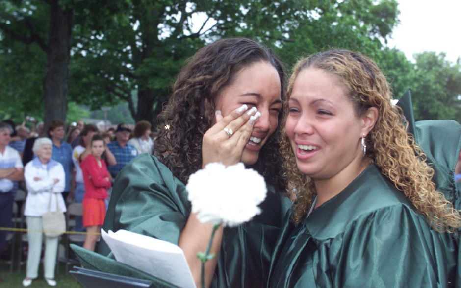 Kristen Ferraro,left, and Charlene Johnson,right, embrace sfter the Maloney High School graduation Thursday night at Maloney High School.