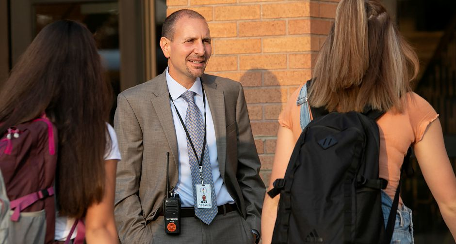 New principal Enzo Zocco greets students entering Sheehan High School on the first day of school in Wallingford, Monday, August 27, 2018. Dave Zajac, Record-Journal
